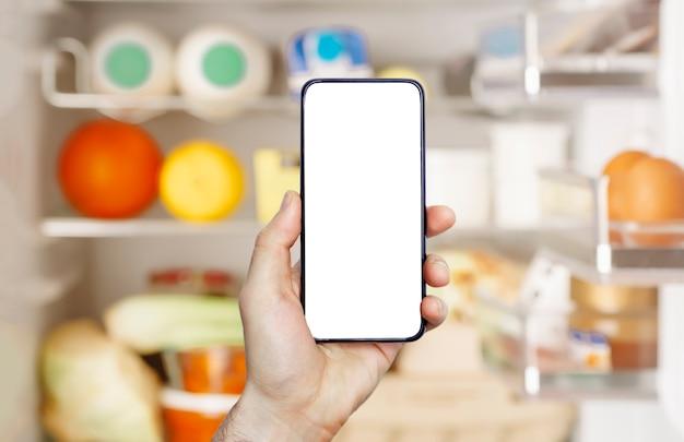 携帯電話のオンライン食料品配達アプリ。スマートフォンでの食品市場サービス。