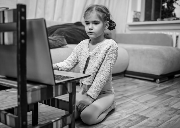 Online hobby, fitness, distant training. young ballerina talking with dance classmates in internet after online ballet class at home, online education