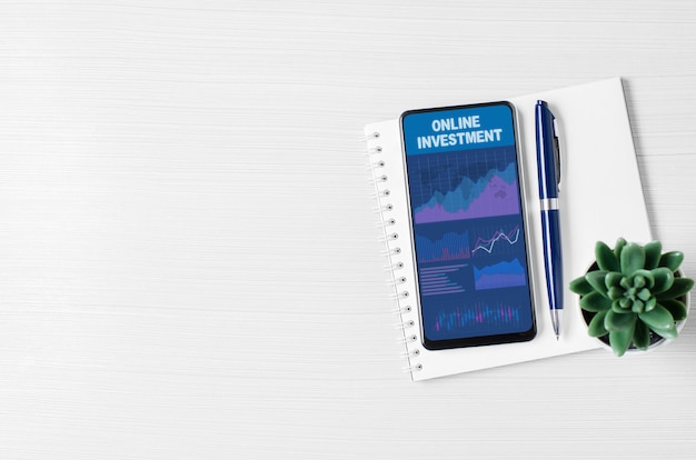 Online investment. charts and graphs on the smartphone screen. the concept of effective investment of money. copy space.