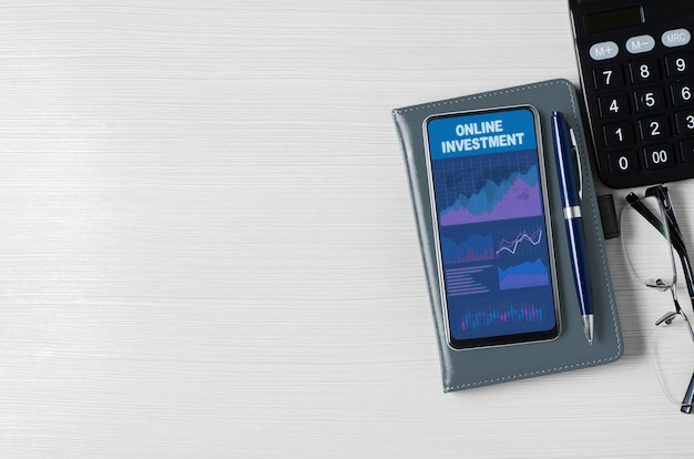 Online investment. charts and graphs on the smartphone screen