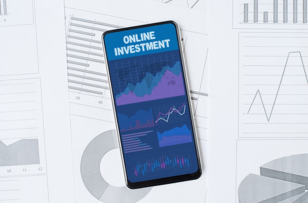 Online investment. smartphone with a mobile app on the background of graphs and charts. copy space.