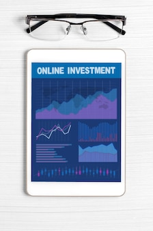 Online investment. tablet with a mobile app with graphs and charts