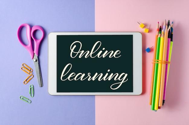Online learning - handwritten inscription on a tablet.