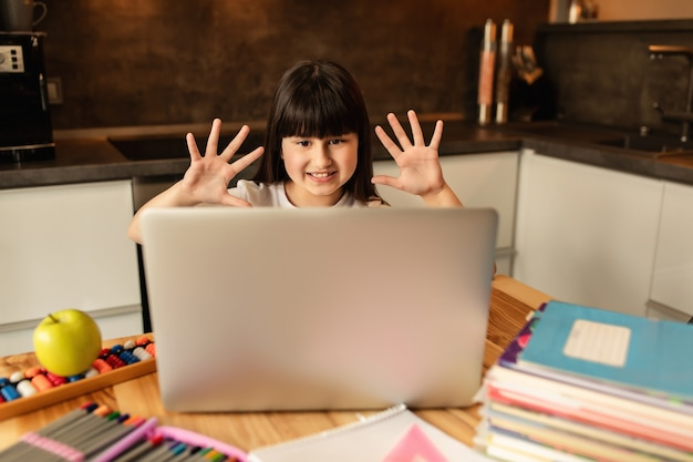 Online learning. schoolgirl at home, online lesson, video call on laptop. distance education, home school