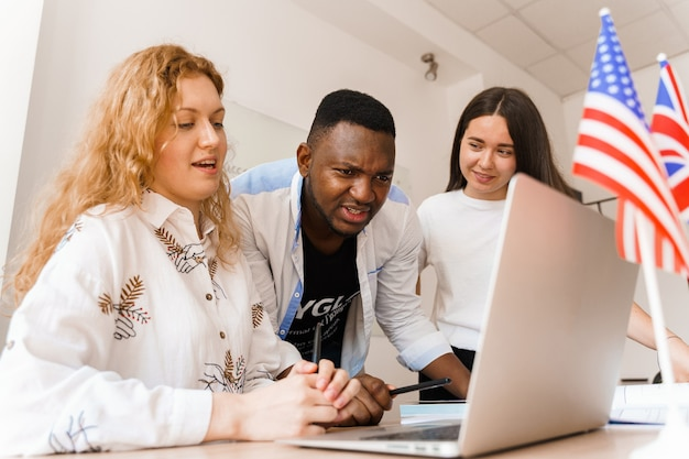 Online multiethnic attractive group of teachers study and laught, discuss something