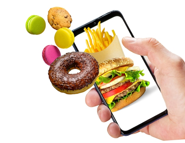 Online ordering fast food. hand holding phone with fast food flying out of the screen