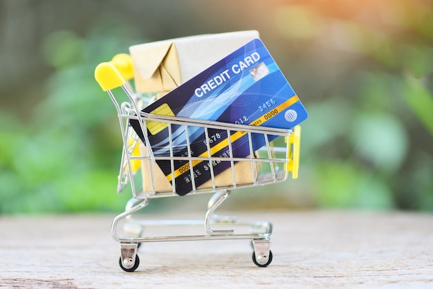 Online payment credit card and parcel boxes in shopping cart. shopping online technology and credit card payment concept