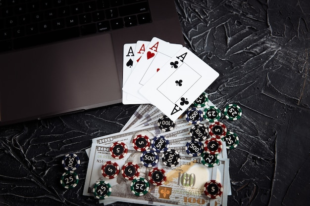 Online poker casino theme. gambling chips and playing cards on grey background.