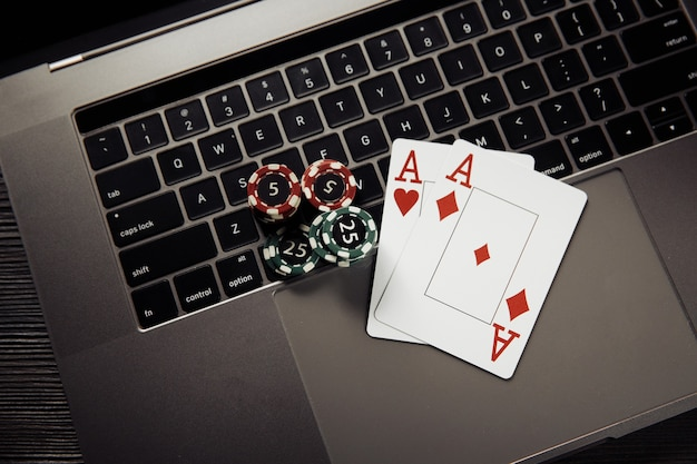 Online poker casino theme. gambling chips and playing cards on keyboard