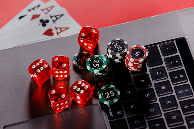 Online poker casino theme. gambling chips with dices and playing cards close-up.