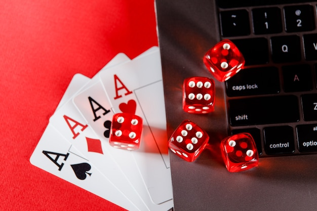 Online poker casino theme playing cards and dices on a red background