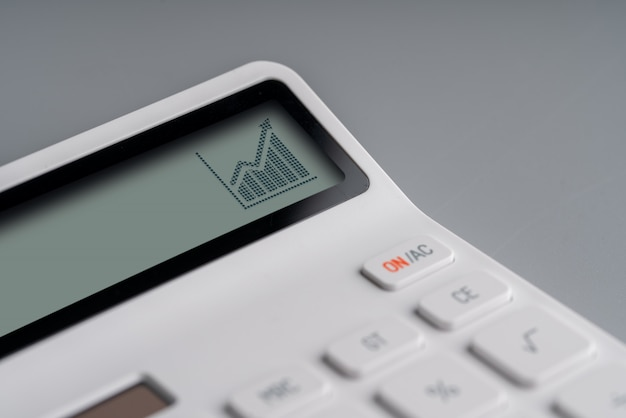 白い電卓のオンラインショッピングとビジネスのアイコン