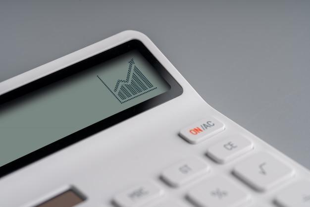 Интернет-магазин и бизнес значок на белом калькуляторе