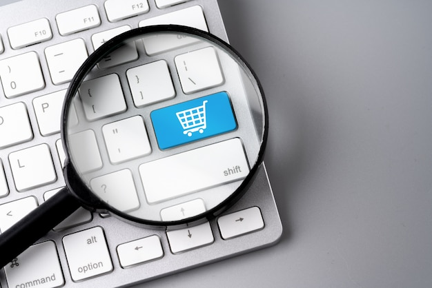 Online shopping & business icon on retro computer keyboard