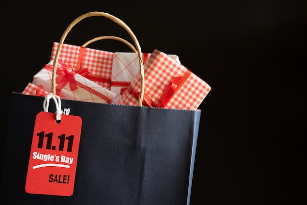 Online shopping of china, 11.11 single day sale. shopping bag and gifts boxes with message