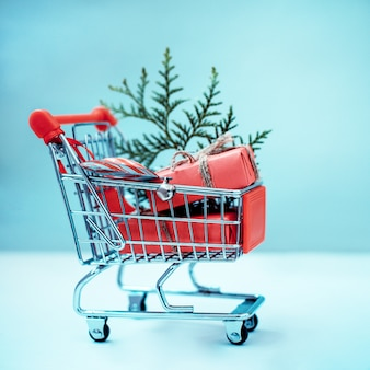 Online shopping concept - trolley full of gifts. black friday and cyber monday