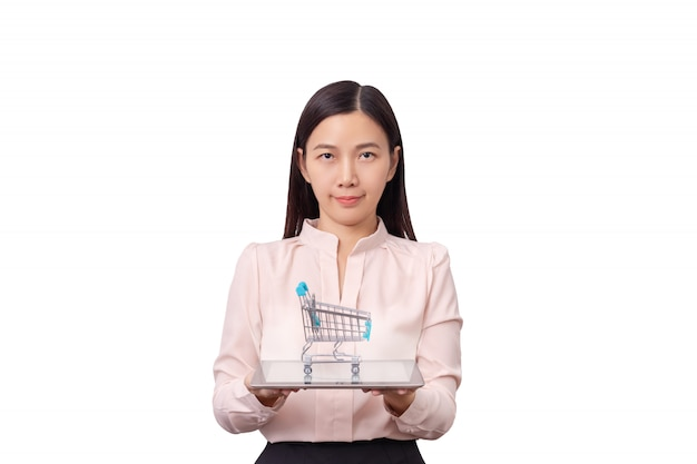 Online shopping and e-commercial business concept. asian beautiful woman holding tablet in hand with shopping cart
