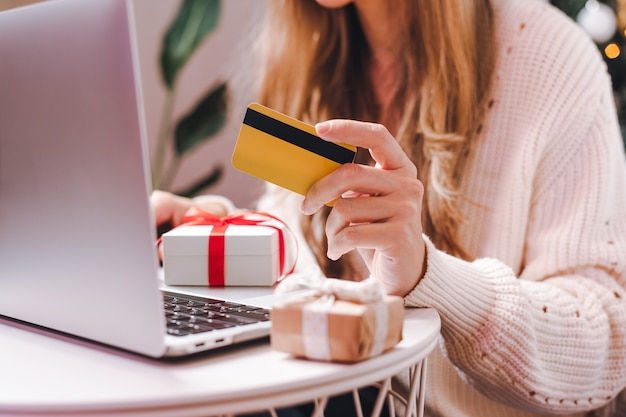 Online shopping at holidays with credit card and laptop.