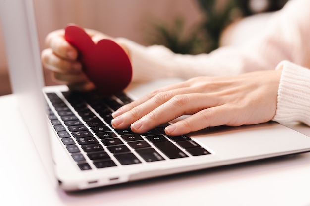Online shopping at holidays with valentine card and laptop.