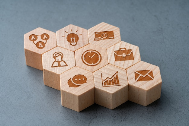 Online shopping icon on wood hexagon puzzle