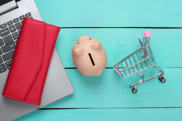 Online shopping ideas laptop with piggy bank supermarket trolley wallet