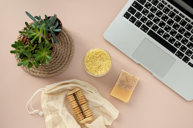 Online shopping. purchase and delivery of natural products for body care. placing order on website via the internet using a laptop.