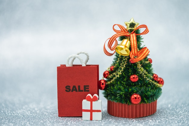 Online shopping and shopping bags delivery service miniature christmas tree