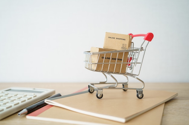 Online shopping with a shopping cart and shopping bags delivery service