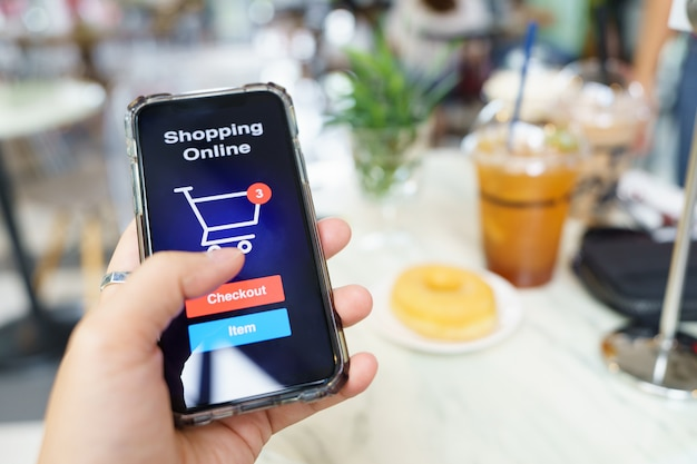 Online shopping with smartphone and shopping bags delivery service using as background shopping
