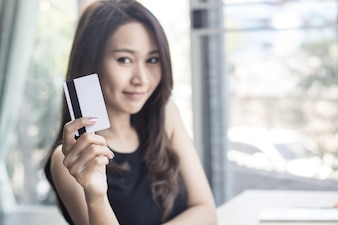 Online shopping women holding credit card