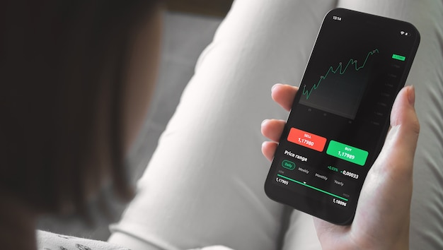 Online stock market with mobile phone. screen with financial graphs. investment and exchange background photo