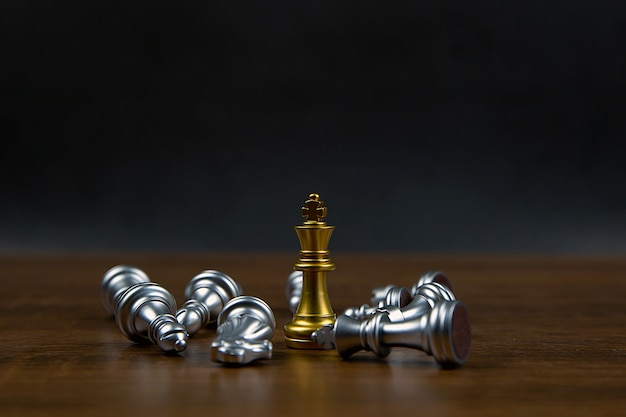 Only one chess standing firmly and another chess that falling.