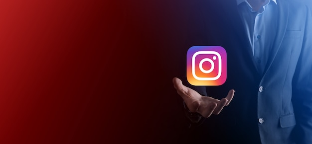 Onok,ukraine - july 14,2021:businessman holds, clicks, instagram icon in his hands.social network.global network and data customer connection.international network.