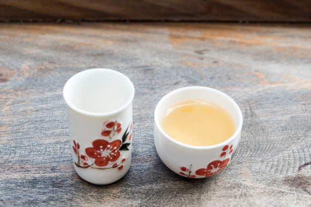 Oolong tea in the traditional chinese style cup.