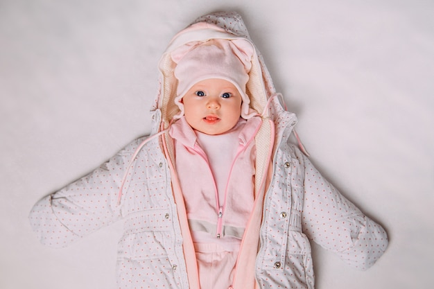 Op view of a cute baby warmly dressed on snow
