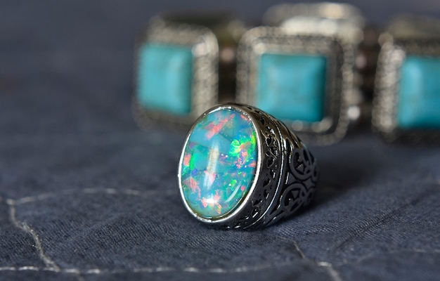 Opal silverring on the flor