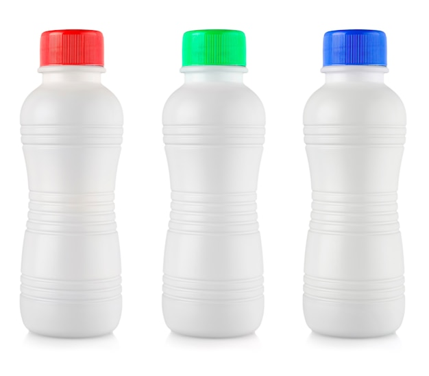 The opaque white plastic bottles with colored lid