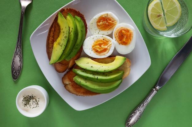 Open avocado sandwiches with eggs