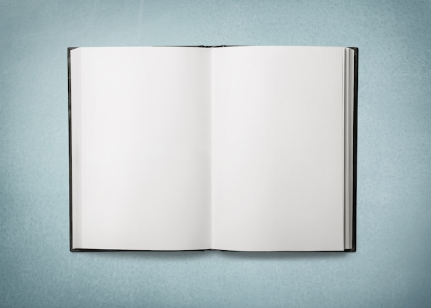 Open blank book on background