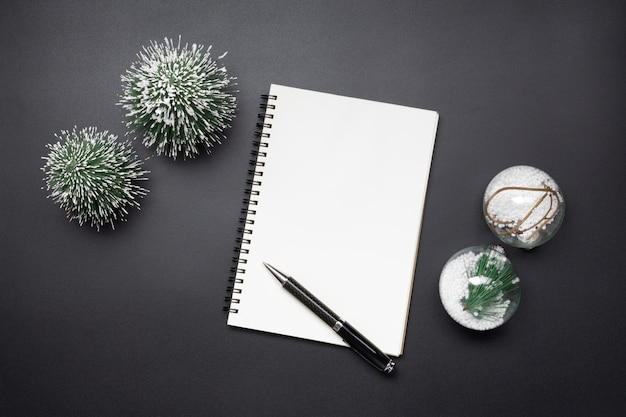 Open blank notebook, christmas ball and mini christmas tree