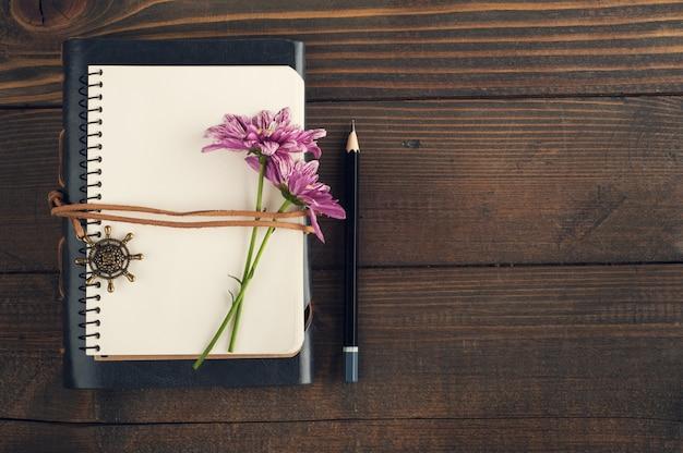 Open blank notebook, flower
