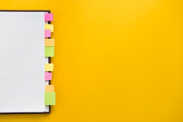 Open blank notebook with colorful sticky bookmarks