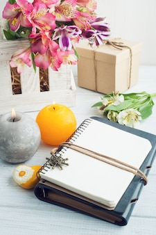 Open blank planner with lit candles