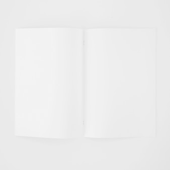 An open blank white page on white background