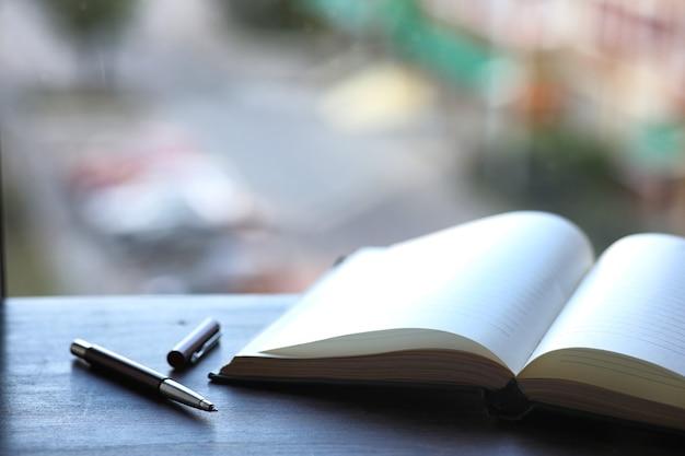 Открытая книга и стол перед окном