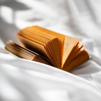 Open book on bedsheet