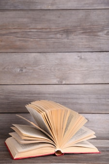 Open book on a grey wooden table