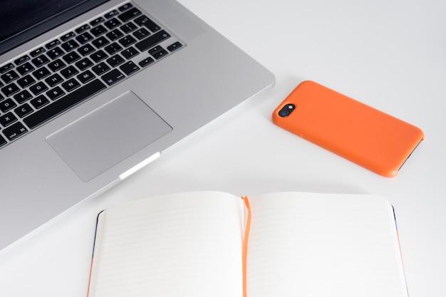 Открытая книга рядом с ноутбуком