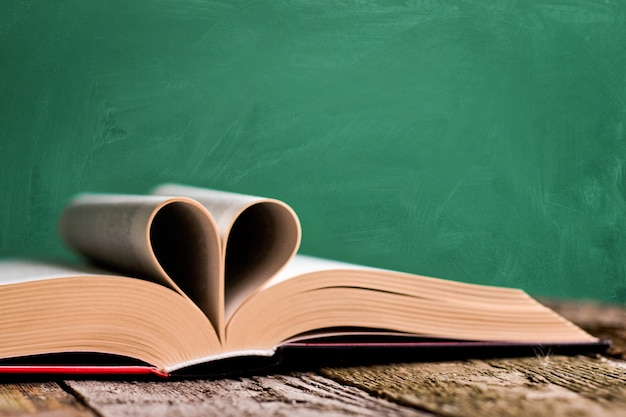 Open book and pages folded in the shape of a heart