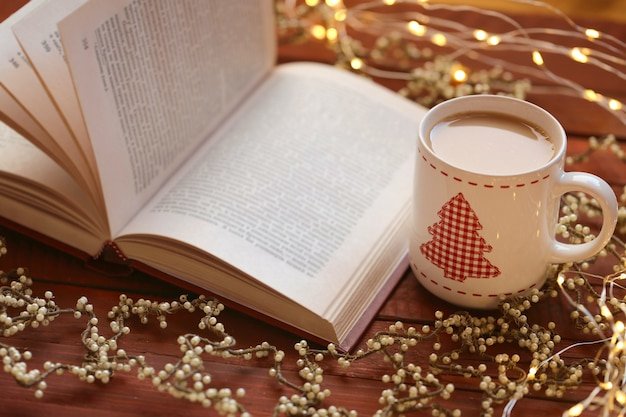 Open book with christmas cup and ornaments